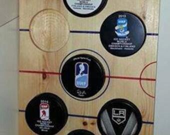 Ice hockey puck holder
