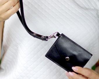 Black card holder with removable hand strap. Mini purse. Wallet. Card case. Envelope wristlet. Fold wallet. Keychain.