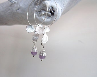 Silver hoop earrings with a sterling silver orchid flower pendant and amethyst. Dainty earrings, yoga jewelry