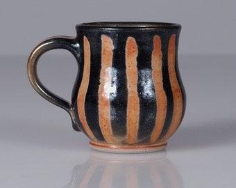 Small Handmade Ceramic Mug with a Tiger-Striped Orange & Black Shino Glaze. Unique Autumn Home Gift. Stoneware Mug by Naomi Anita
