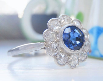 Classic Vintage Sapphire and Diamond Daisy Cluster Engagement Ring. Radiant Natural .50 Carat Blue Sapphire & .55 Old European Cut Diamonds.