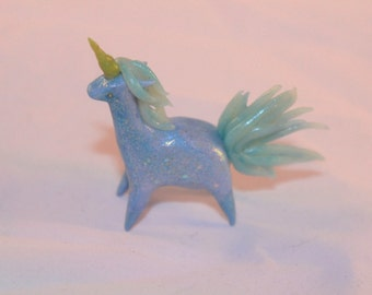 Glittery blue unicorn sculpture
