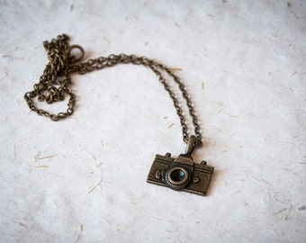 Necklace with a vintage inspired camera pendant