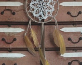 Huge mustard dream catcher made with leather and feathers.