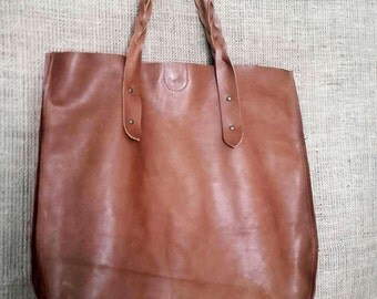 Handmade brown leather tote bag with braided handles