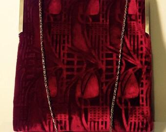 A deep crimson red  kisslock handbag in a Charles Rennie Mackintosh design