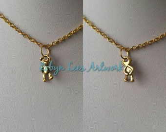 Small Gold Teddy Bear Walking With Hands Behind His Back Necklace on Gold Crossed Chain