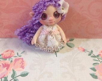 Mini doll lilac