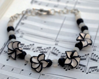 Leather Anklet with Polymer Clay Black and White Pinwheel Flowers Hypoallergenic ITEM 420B