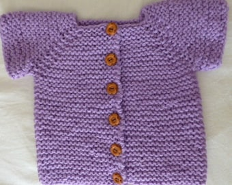 Handknitted jacket with short sleeves and wooden flowers