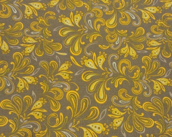 dark gray background with yellow and blue/green swirl quilting fabric by the yard