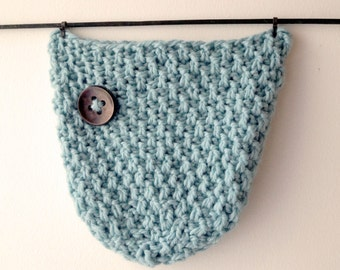 Blue knitted hat, button. AVA