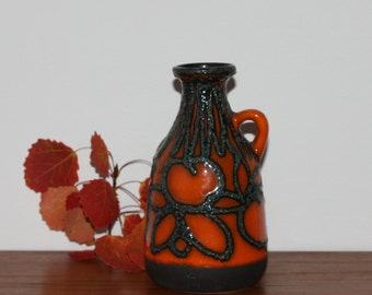 Great vintage retro ceramic handled Vase. Glossy orange glaze with black lava. Made by Scheurich, West Germany