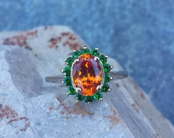 Spessartine, orange garnet with Tsavorite, green garnet in 14k white gold ring.