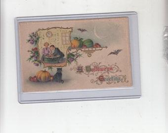 A Halloween Greeting Antique Postcard-Black Cat- Bobbing Apples-Bats-Embossed-Gold Printing-Unused