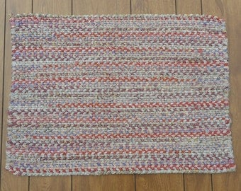 Muted shades of Coral, Yellow, Brown, Purple, Pink and Green Rectangular shaped Twined Rag Rug