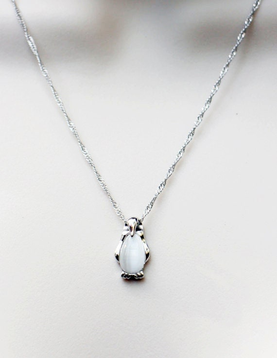 sterling silver penguin necklace cat s eye white bead in