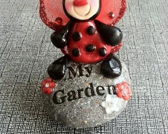 Handmade Polymer Clay Lady Bug sitting on a Welcome Garden Rock