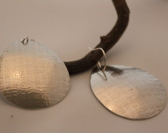 large tear drop silver earrings,textured, polished