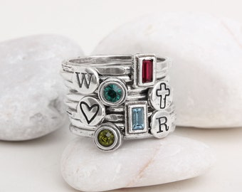 Stacking Family Ring includes 4 Initial Stack Rings and 4 Birthstone Rings in Sterling Silver.  Total of 8 Stacking Rings in set.