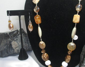 Creams and Browns Mix Textures and Beads Unique discribes this Necklace best