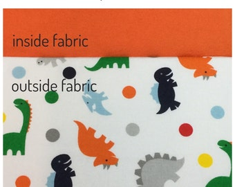 flip and go travel diaper changing pad/baby changing pad/travel diaper clutch with pockets, dinosaurs in primary colors