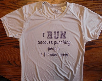 I run because punching people is frowned upon woman's performance t-shirt