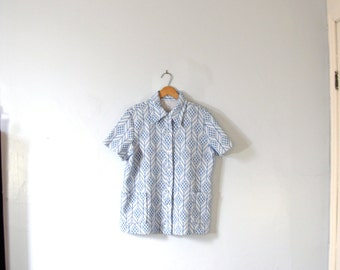 Vintage 70's light blue blouse with geometric pattern, women's medium