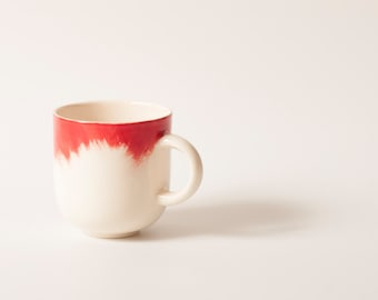 Handmade Ceramic mug with red brushstrokes H: 3″