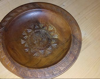 Wood collecting/offering patterned plate.