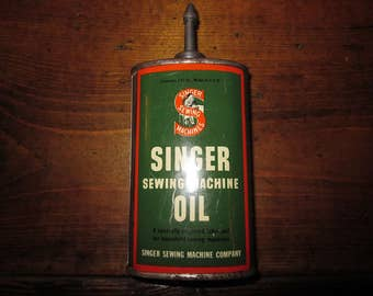 Vintage Singer Sewing Machine Oil Tin With lead top 3 oz.