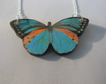 small tatty blue wood laser cut butterfly moth necklace statement spring devine