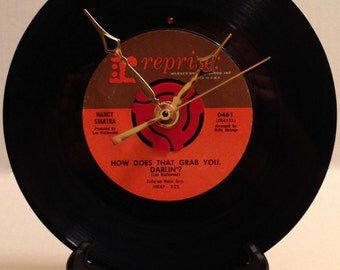 """Recycled NANCY SINATRA 7"""" Record • How Does That Grab You. Darling? • Record Clock"""