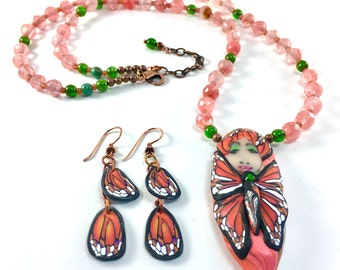 Butterfly goddess necklace , face bead, polymer clay artisan pendant