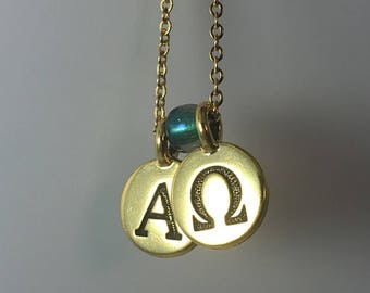 Alpha Omega charm necklace, gold chain and gold plated pewter alphabet charms, green glass bead. Christian gift.  Greek letters.