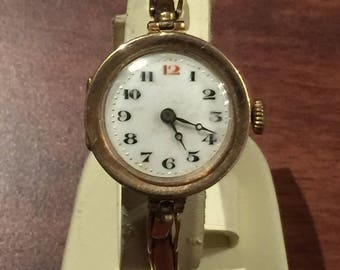 An Art-Deco 9K Yellow Gold ladies' Bracelet Watch. Circa 1930's. Porcelain Dial. Hinged case. Breguet Hands.