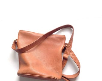 Coach bag. Minimalist coach bag. Vintage caramel brown, pebbled leather, crossbody bag from COACH.