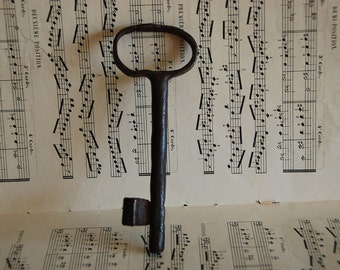 Very old French key, 6.29  inches in length with solid shank with plain  bow and collar. 16.3cms. Wedding favour.