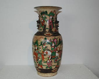 Large Chinese Nanking Antique crackle glazed porcelain vase. Warrior Scenes with raised dragons. Good condition. Signed.
