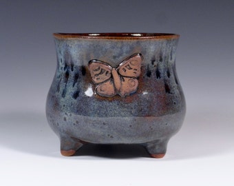 Butterfly 3 footed wine/tea cup.  Handmade pottery.