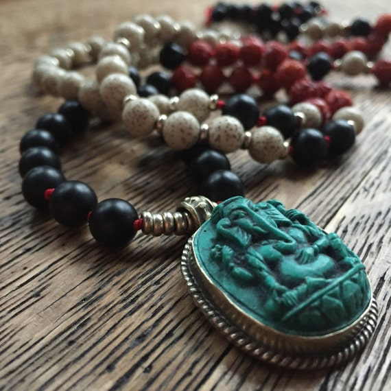 108 Bead Partially Handknotted Lotus Seeds, Matte Onyx, Carved Coral + Ganesh Pendant Yoga and Meditation Mala