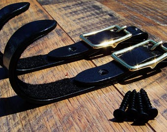 Blacksmith made Buckle Gun rack hangers (Wall mount), made to look like a leather strap with a brass buckle.