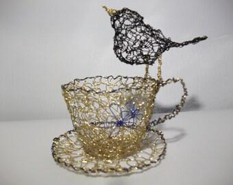 vintage style teacup with blackbird