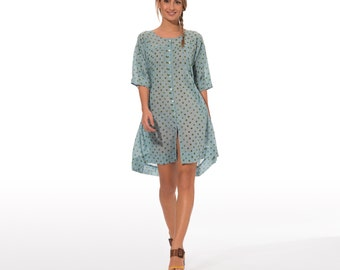 elegant summer dress half sleeves pure cotton with green pois and light blue background