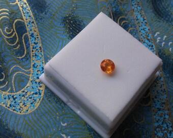 Approximately .65ct 5.5mm Round Mandarin Garnet