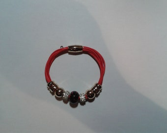 Red charms bracelet