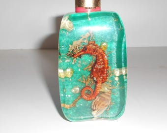 Vintage 70's Table Lighter in translucent blue resin with inclusions of shells, Retro, and Stylish.