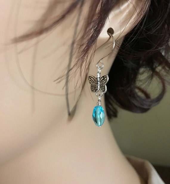 Diffuser or Fashion Earrings. Small Silver Butterfly. Aqua Faceted Glass Bead Dangle. Sterling Silver Ear Wire Option. Lava Stone Diffuser