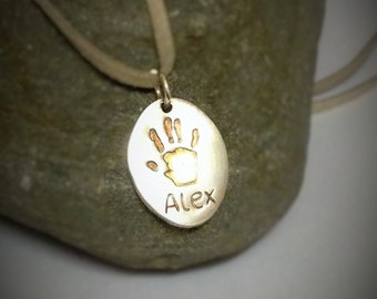 Hand print jewellery. Oval hand, foot print pendant. Personalised with loved ones handprints, foot/ paw prints. Brushed/matte silver.
