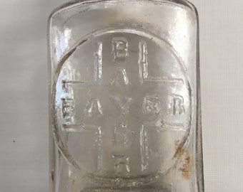 Antique Bayer bottle, very old glass, this was an early bottle, ca. 1910. This was during the time that heroin was marketed.